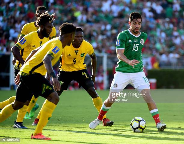 Rodolfo Pizarro of Mexico dribbles from Owayne Gordon and Ladale Richie of Jamaica during the first half of the CONCACAF 2017 semifinal at Rose Bowl...
