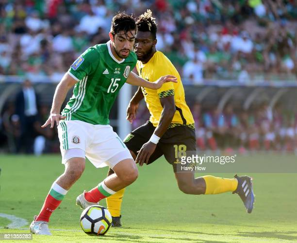 Rodolfo Pizarro of Mexico dribbles from Owayne Gordon of Jamaica during the first half of the CONCACAF 2017 semifinal at Rose Bowl on July 23 2017 in...