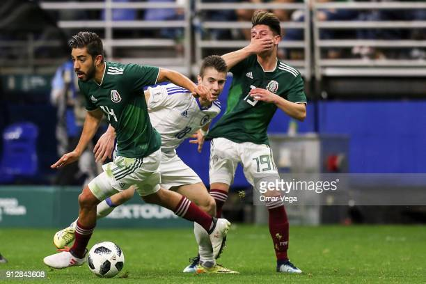 Rodolfo Pizarro of Mexico fights for the ball with Dino Besirovic of Bosnia during the friendly match between Mexico and Bosnia and Herzegovina at...
