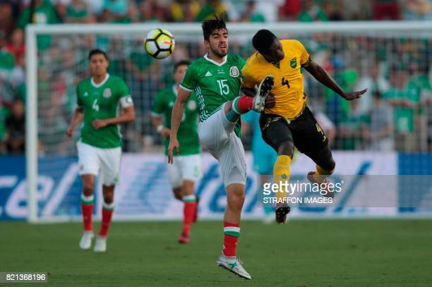 Rodolfo Pizarro of Mexico fights for the ball with Ladale Richie of Jamaica during a match between Mexico and Jamaica as part of CONCACAF Gold Cup...