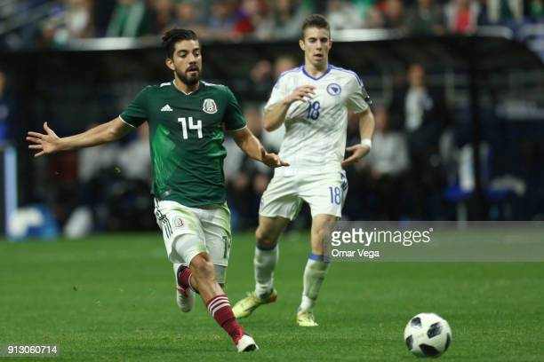 Rodolfo Pizarro of Mexico runs for the ball during the friendly match between Mexico and Bosnia and Herzegovina at Alamodome Stadium on January 31...