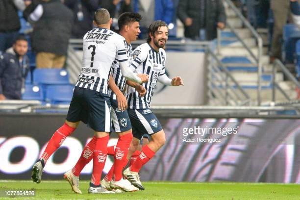 Rodolfo Pizarro of Monterrey celebrates with teammates after scoring his team's first goal during the semifinal first leg match between Monterrey and...