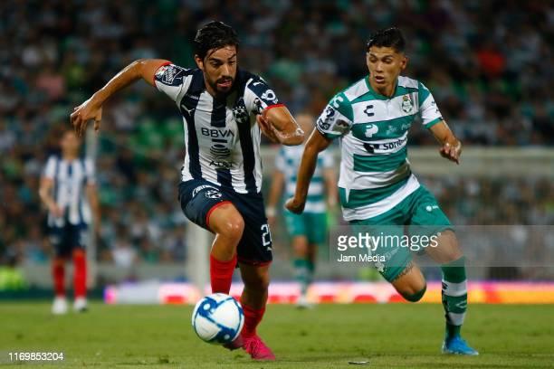Rodolfo Pizarro of Monterrey fights for the ball with Gerardo Arteaga of Santos during the 6th round match between Santos Laguna and Monterrey as...