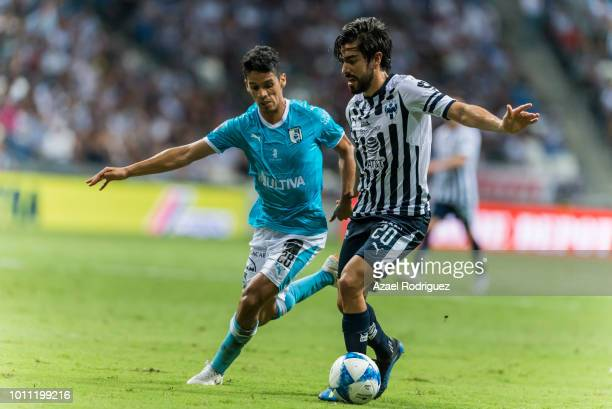 Rodolfo Pizarro of Monterrey fights for the ball with Jaime Gomez of Queretaro during the third round match between Monterrey and Queretaro as part...