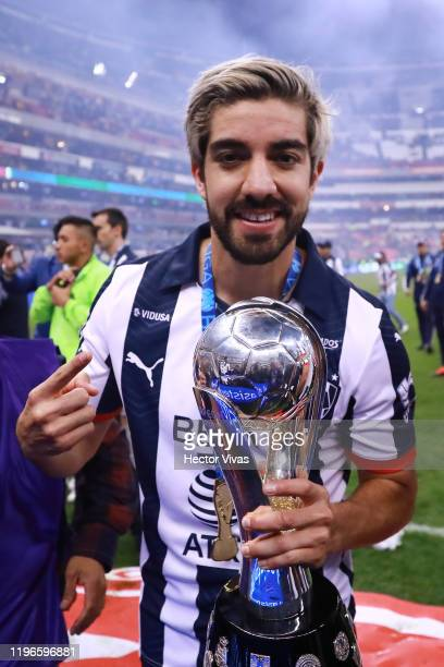 Rodolfo Pizarro of Monterrey poses with the champions trophy after the Final second leg match between America and Monterrey as part of the Torneo...