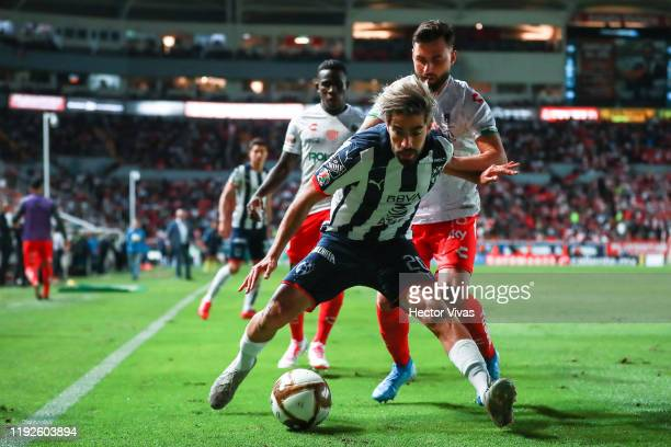 Rodolfo Pizarro of Monterrey struggles for the ball against Luis Gallegos of Necaxa during the Semifinals second leg match between Necaxa and...