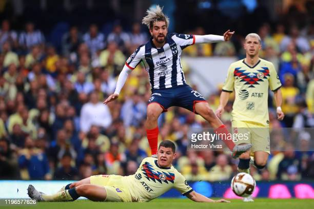 Rodolfo Pizarro of Monterrey struggles for the ball against Richard Sánchez of America during the Final second leg match between America and...