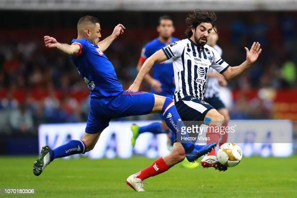 Rodolfo Pizarro of Monterrey struggles for the ball with Pablo Aguilar of Cruz Azul during the semifinal second leg match between Cruz Azul and...
