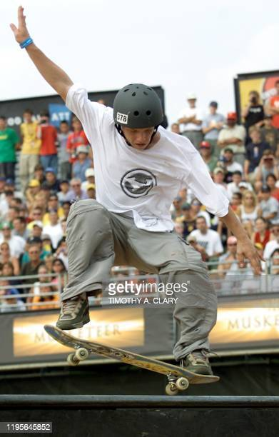 Rodolfo Ramos of Brazil does a trick on the rails during the Men's Skateboard Park final's at the 2001 Summer X Games at the First Union Complex in...