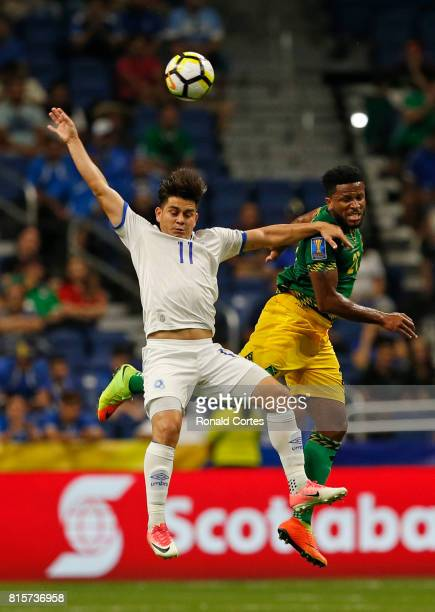 Rodolfo Zelaya of El Salvador battles Jermaine Taylor of Jamaica in the first half during the 2017 CONCACAF Gold Cup at Alamodome on July 16 2017 in...