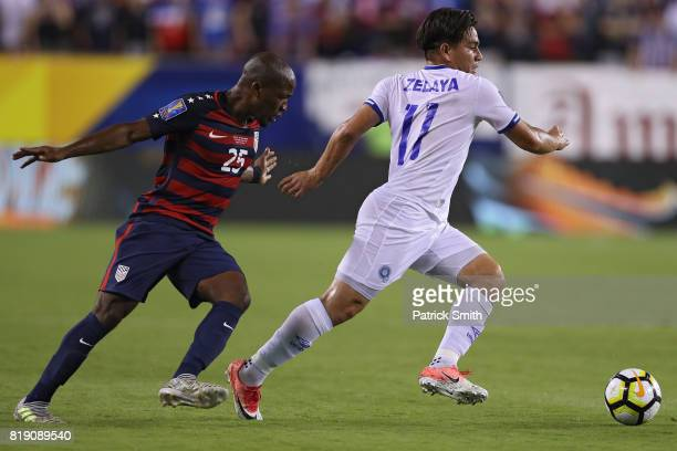 Rodolfo Zelaya of El Salvador dribbles past Darlington Nagbe of the United States in the first half during the 2017 CONCACAF Gold Cup Quarterfinal at...