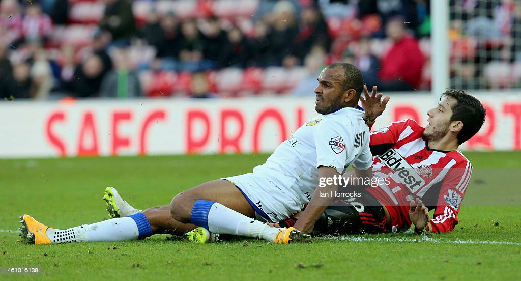 Rodolph Austin of Leeds United (L) challenging Ricky Alverez of Sunderland during the FA Cup third round match between Sunderland and Leeds United at the Stadium of Light on January 04, 2015 in Sunderland, England.