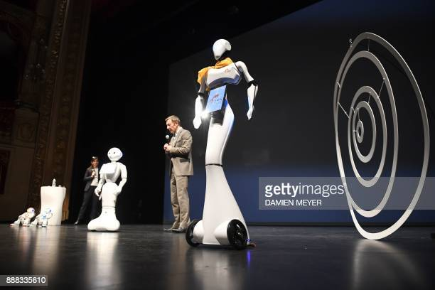 Rodolphe Gelin Softbank robotics' chief scientific officer delivers a speech among Maava pepper and Nao robots during the digital tech show in Rennes...