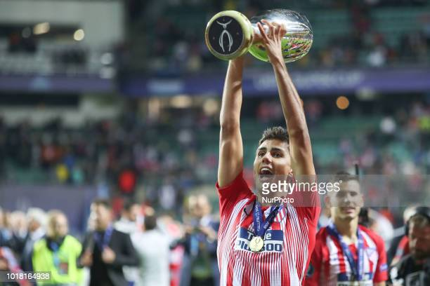 Rodri of Atletico Madrid celebrates with the trophy after winning the UEFA Super Cup between Real Madrid and Atletico Madrid at Lillekula Stadium on...