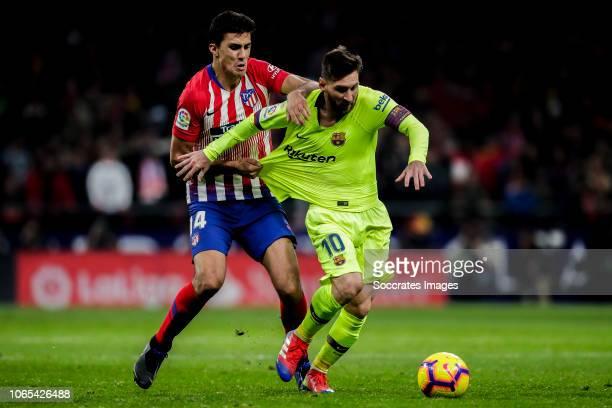 Rodri of Atletico Madrid Lionel Messi of FC Barcelona during the La Liga Santander match between Atletico Madrid v FC Barcelona at the Estadio Wanda...