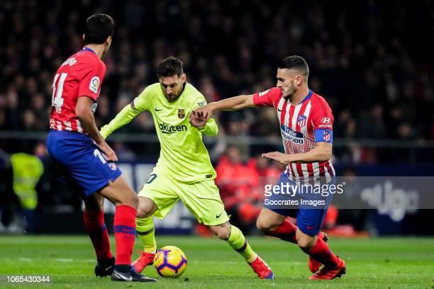 Rodri of Atletico Madrid Lionel Messi of FC Barcelona Koke of Atletico Madrid during the La Liga Santander match between Atletico Madrid v FC...