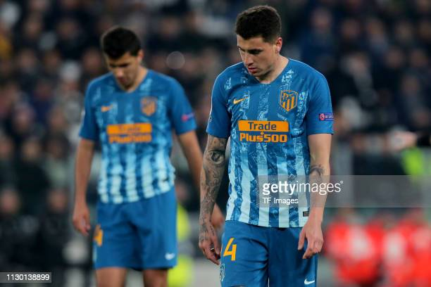 Rodri of Club de Atletico Madrid and Jose Maria Gimenez of Club de Atletico Madrid look dejected during the UEFA Champions League Round of 16 Second...
