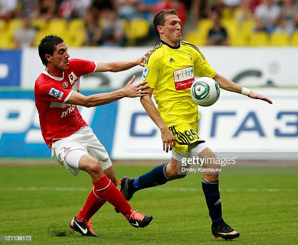 Rodri of FC Spartak Moscow battles for the ball with Alexander Prudnikov of FC Anzhi Makhachkala during the Russian Football League Championship...