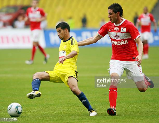 Rodri of FC Spartak Moscow battles for the ball with Mbark Boussoufa of FC Anzhi Makhachkala during the Russian Football League Championship match...