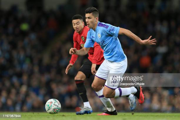 Rodri of Man City battles with Jesse Lingard of Man Utd during the Carabao Cup Semi Final match between Manchester City and Manchester United at the...