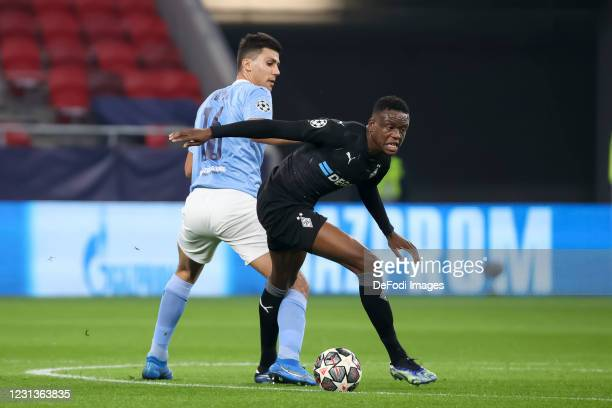 Rodri of Manchester City and Alassane Plea of Borussia Moenchengladbach battle for the ball during the UEFA Champions League Round of 16 match...