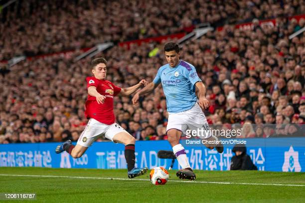 Rodri of Manchester City and Daniel James of Manchester United during the Premier League match between Manchester United and Manchester City at Old...