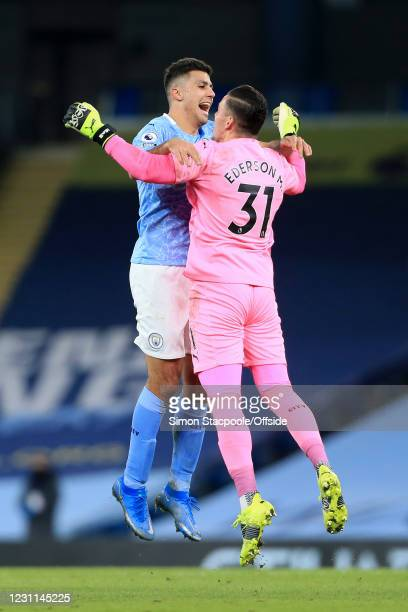 Rodri of Manchester City congratulates Manchester City goalkeeper Ederson aftere his assist set up their 3rd goal during the Premier League match...