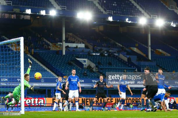 Rodri of Manchester City heads wide during the Premier League match between Everton and Manchester City at Goodison Park on February 17, 2021 in...