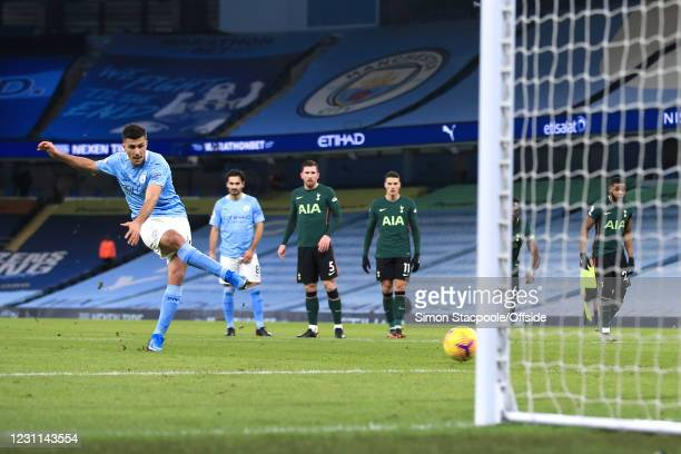 Rodri of Manchester City scores their 1st goal with a penalty during the Premier League match between Manchester City and Tottenham Hotspur at Etihad...