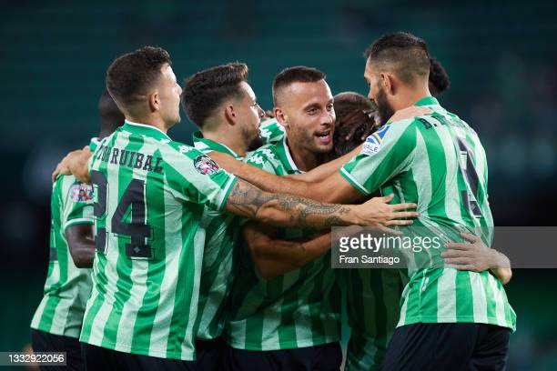 Rodri Sanchez of Real Betis celebrates scoring a goal with team mates during a friendly match between Real Betis and AS Roma at Estadio Benito...