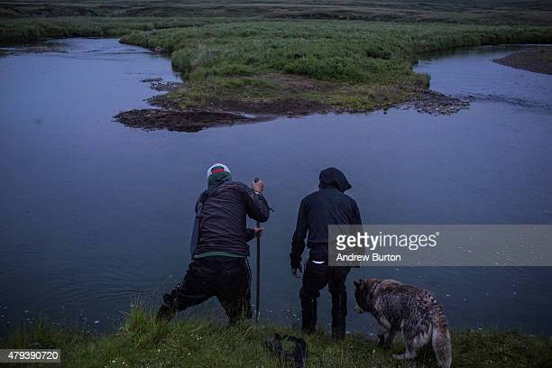 Rodrick Stewart and Robert Page hunt for beaver on Nelson Island on July 2 2015 near Newtok Alaska Newtok has a population of approximately of 375...
