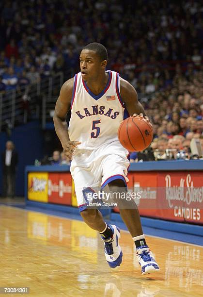 Rodrick Stewart of the Kansas Jayhawks dribbles the ball against the Oklahoma State Cowboys during the game on January 10, 2007 at Allen Fieldhouse...