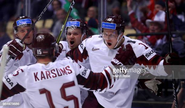 Rodrigo Abols of Latvia celebrate with his team mates after he scores the equalizing goal during the 2018 IIHF Ice Hockey World Championship group...