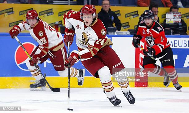 Rodrigo Abols of the Acadie-Bathurst Titan skates with the puck against the Quebec Remparts during their QMJHL hockey game at the Centre Videotron on...