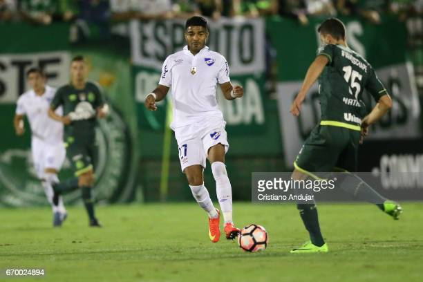 Rodrigo Aguirre of Nacional Uruguay struggles for the ball with Nathan of Chapecoense during a match between Chapecoense and Nacional Uruguai as part...