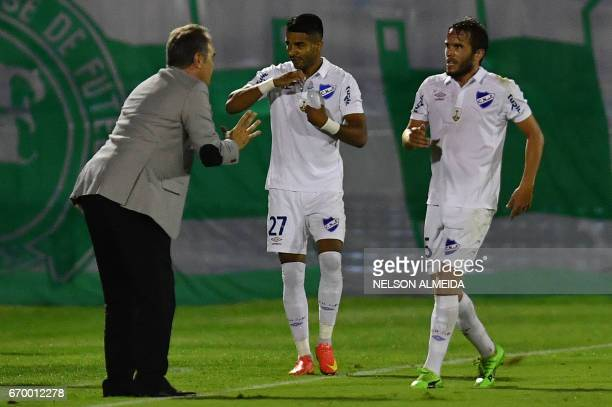 Rodrigo Aguirre of Uruguay's Nacional celebrates with team coach Martin Lasarte after scoring against Brazil's Chapecoense during their 2017 Copa...
