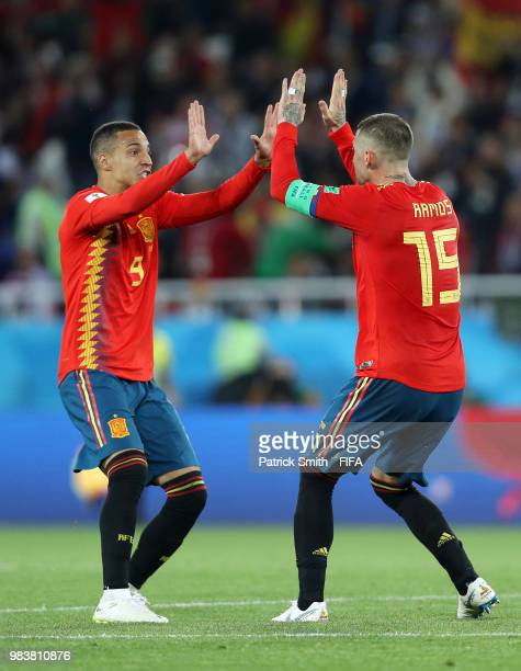 Rodrigo and Sergio Ramos of Spain celebrate after Iago Aspas of Spain scores their team's second goal during the 2018 FIFA World Cup Russia group B...