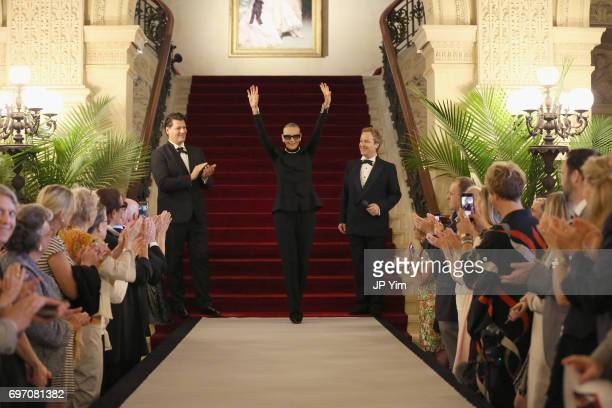 Rodrigo Basilicata Maryse Gaspard and Matthew Gonder walk the runway during the Pierre Cardin 70 Years of Innovation fashion show at The Breakers on...
