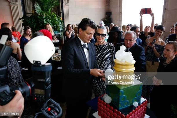 Rodrigo Basilicati and Maryse Gaspard celbrate after the Pierre Cardin 70 Years Of Innovation fashion show at The Breakers on June 17 2017 in Newport...