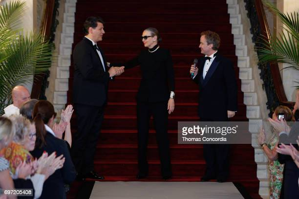 Rodrigo Basilicati Maryse Gaspard and Mathew Gonder greet the audience after the Pierre Cardin 70 Years Of Innovation fashion show at The Breakers on...