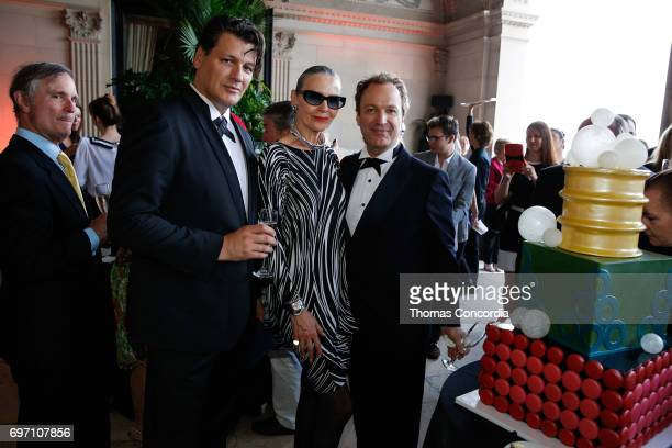 Rodrigo Basilicati Maryse Gaspard and Mathew Gonder prepare to cut the cake after the Pierre Cardin 70 Years Of Innovation fashion show at The...