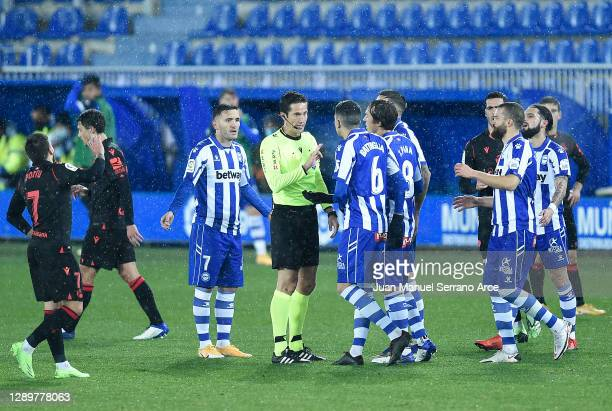 Rodrigo Battaglia of Alaves is shown a red card by referee Jose Luis Munuera Montero during the La Liga Santander match between Deportivo Alaves and...