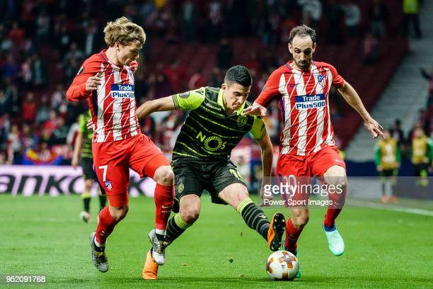 Rodrigo Battaglia of Sporting CP fights for the ball with Antoine Griezmann of Atletico de Madrid and Juan Francisco Torres Belen Juanfran of...