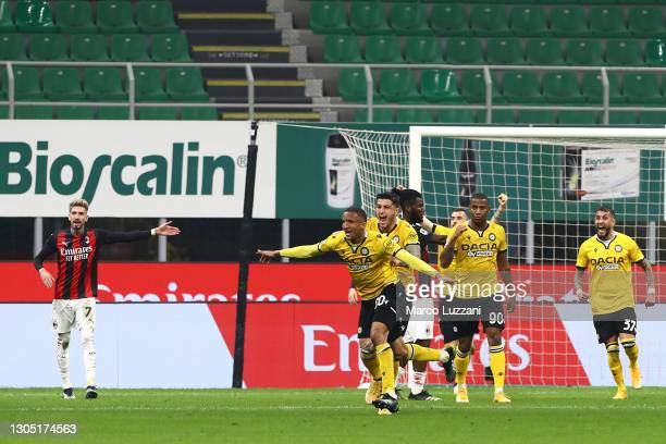 Rodrigo Becao of Udinese Calcio celebrates after scoring their side's first goal during the Serie A match between AC Milan and Udinese Calcio at...