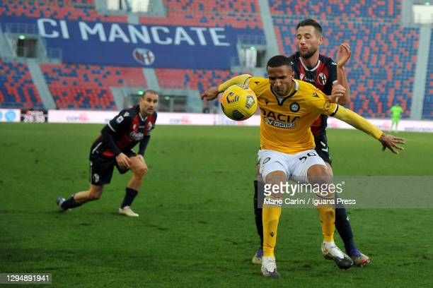 Rodrigo Becao of Udinese Calcio competes for the ball with Mitchell Dijks of Bologna FC during the Serie A match between Bologna FC and Udinese...
