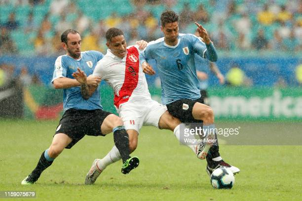 Rodrigo Bentancur and Diego Godin of Uruguay fights for the ball with Paolo Guerrero of Peru during the Copa America Brazil 2019 quarterfinal match...