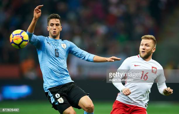 Rodrigo Bentancur from Uruguay fights for the ball with Jakub Blaszczykowski from Poland during the International Friendly match between Poland and...