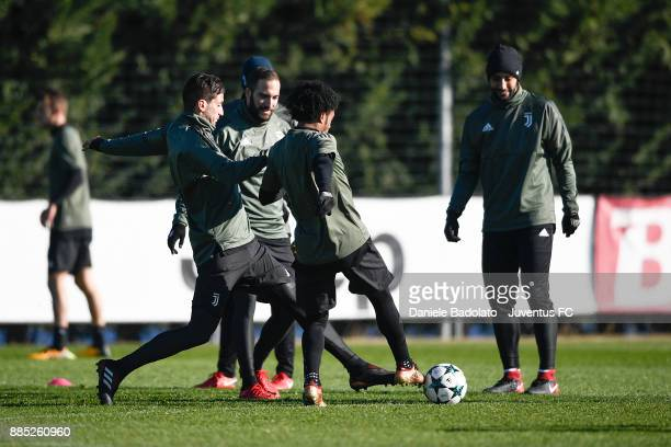 Rodrigo Bentancur Gonzalo Higuain and Juan Cuadrado during a Juventus Training Session at Juventus Center Vinovo on December 4 2017 in Vinovo Italy