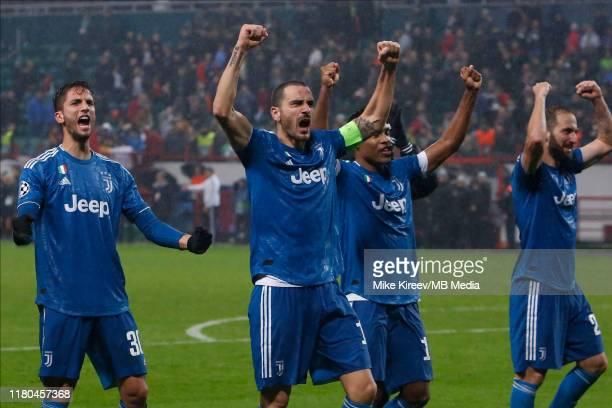 Rodrigo Bentancur, Leonardo Bonucci, Alex Sandro and Gonzalo Higuain of Juventus celebrate victory during the UEFA Champions League group D match...