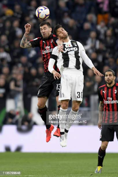 Rodrigo Bentancur of Juventus and Alessio Romagnoli of AC Milan heads the ball during the Serie A match between Juventus and AC Milan on April 6,...